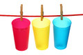 Three empty plastic cups clothesline isolated white background Royalty Free Stock Photo