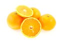 Three entire and one cut mandarin isolated on white background Royalty Free Stock Image