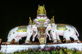 Three Erawan statues and symbols King, In front of Grand Palace, Emerald Buddha Temple, Wat Phra Kaew in Bangkok Royalty Free Stock Photo