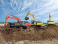 Three Excavators Royalty Free Stock Images
