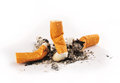 Three Extinguished Cigarettes with Ashes Royalty Free Stock Photo