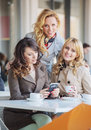 Three fabulous women drinking coffee ladies Royalty Free Stock Photos