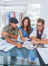 Three fashion designers during a brainstorming in bright office Stock Images