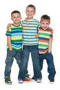 Three fashion little boys cute are standing together on the white background Royalty Free Stock Images