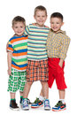 Three fashion little boys in striped shirt cute are standing together on the white background Royalty Free Stock Image