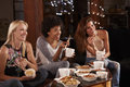 Three female friends eating a Chinese take-away watching TV Royalty Free Stock Photo