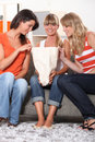 Three female friends looking shopping bag Stock Photography