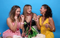Three female friends talking and laughing Stock Image