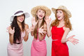 Three female friends on white background Stock Image