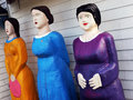 Three female statues in bright clothing Royalty Free Stock Photo