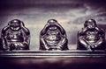Three figures of buddah philosophy buddha on wooden background Stock Images