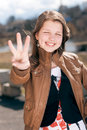 Three fingers by beautiful young woman outdoor Royalty Free Stock Image