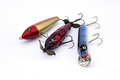 Three fishing lure top water shallow and deep water buzz bait for fresh in red color head white body on white background Stock Images