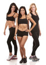 Three fitness women beautiful wearing on white background Royalty Free Stock Image