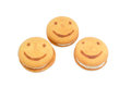Three flaky cookies with the image of smiling face Royalty Free Stock Photo