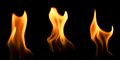 Three flames hand shaped on a black background Royalty Free Stock Images