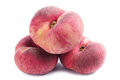 Three flat peaches on white background Royalty Free Stock Image