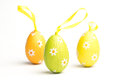 Three foil wrapped easter eggs daisy pattern yellow tag Stock Images
