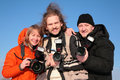 Three fotographers against blue sky 2 Stock Images