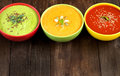 Three fresh soups on a wooden table Royalty Free Stock Photo