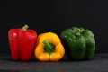 Three fresh sweet pepper isolated on black blackgr Royalty Free Stock Photo