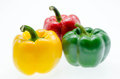 Three fresh sweet pepper isolated on white background Royalty Free Stock Photo