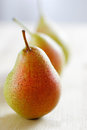 Three fresh uncooked pears row shallow depth field Stock Photos