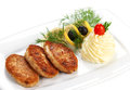 Three fried meat cutlets with garnish on a white plate Stock Images