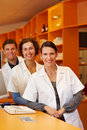 Three friendly pharmacists Stock Photos