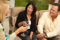 Three Friends Enjoying Wine on the Patio Royalty Free Stock Images