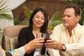 Three Friends Enjoying Wine on the Patio Royalty Free Stock Photo