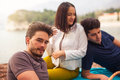 Three friends having fun at the beach, springtime Royalty Free Stock Photo