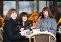 Three friends parisian street cafe Royalty Free Stock Photo