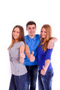Three friends show a thumbs up sign on white backg the background Stock Image