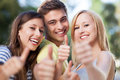 Three friends with thumbs up Stock Photography