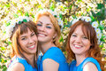 Three friends with wreaths on the head Royalty Free Stock Photo