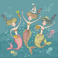 Three funny mermaids little playing in the sea waves Stock Photography