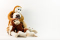 Three funny monkeys toy or doll isolated in white background posing Royalty Free Stock Photos