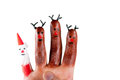 Three funny reindeer and santa painted on the fingers of a human hand Stock Photo