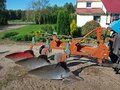 Three furrow plow tractor powered in country yard Royalty Free Stock Photography