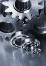 Three gear-wheels and ball-bearings Royalty Free Stock Images