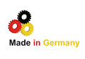 Three gear wheels in german colors Stock Photography