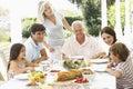 Three Generation Family Enjoying Meal Outdoors Royalty Free Stock Photo
