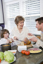 Three generation family in kitchen eating lunch Royalty Free Stock Photography