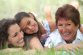 Three generations of women in a park Stock Images