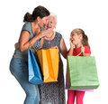 Three generations of women with shopping bags on a white background Stock Images