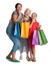 Three generations of women with shopping bags on a white background Royalty Free Stock Image