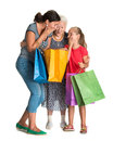 Three generations of women with shopping bags on a white background Stock Photo