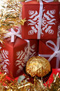 Three gift boxes and one luxury golden sweet Stock Photo