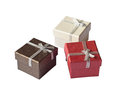 Three gift boxes with silver ribbon isolated on white Stock Image